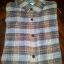 เสื้่อเชิ๊ตลายสก๊อตสีน้ำตาล ราคา 150 บาท thumbnail 1
