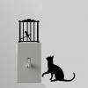"""สติ๊กเกอร์ติดปลั๊กไฟ """"แมวกับกรงนก"""" ขนาดซองบรรจุ 15 x 12 cm"""