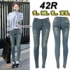 กางเกงยีนส์เอวต่ำ ขาเดฟ ผ้ายืด กระดุม 3 เม็ด สีฟ้าเทาอมเหลือง แต่งขาดหน้าขา สุดเท่ มี SIZE L,XL